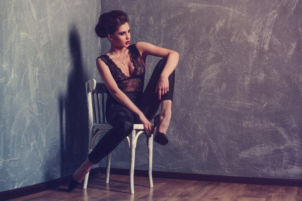Studio fashion portrait of young beautiful sexy woman